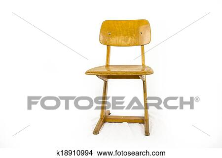 stock photo of old used wooden school chair for the young pupils