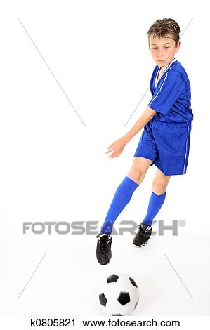 stock photography of child kicking ball k0805821 search stock