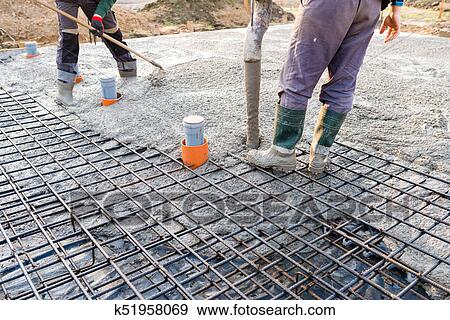 Pouring Concrete Slab During Commercial Concreting Floors Of Buildings In Construction
