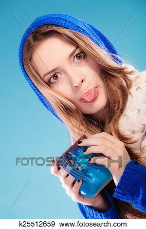 Hot Beverage Closeup Funny Teen Girl Holding Blue Mug With Drink Tea Or Coffee Woman Having Fun Making Silly Face Sticking Tongue