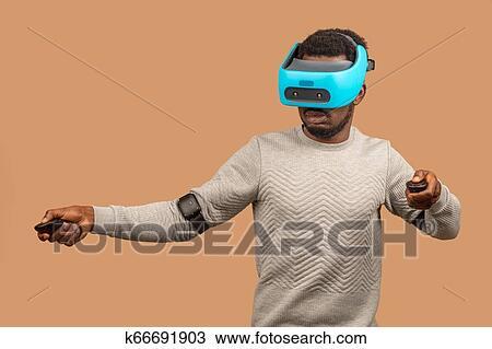 0bead1b4ddaf Stock Photo of Black man wearing 3d vr glasses