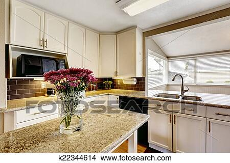 Kitchen Island With Granite Top And Flowers Picture K22344614 Fotosearch