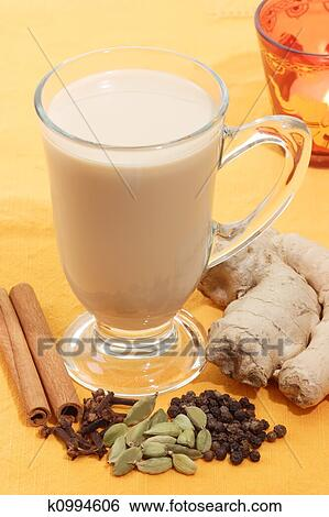 Indian Tea With Different Sorts Of Spices On Yellow Background