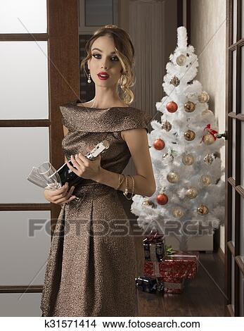 6f0537fb1 Stock Photo - elegant girl in christmas holiday . Fotosearch - Search Stock  Images