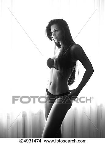 31032d335 young-beautiful-sexy-woman-in-black-picture  k24931474.jpg
