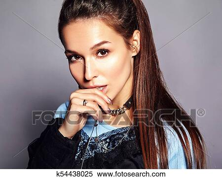 debdad0d217 Beautiful caucasian hipster brunette woman model in bright black summer  stylish clothes posing on gray background. Touching her lips