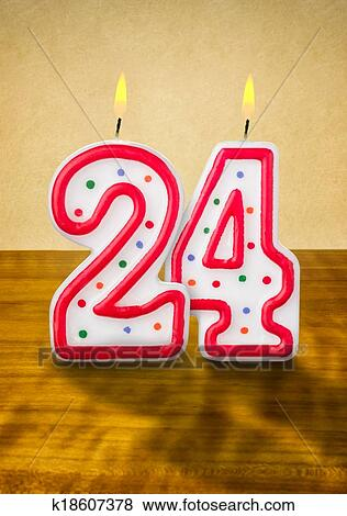 burning-birthday-candles-number-24-stock