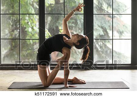 young attractive woman in ustrasana pose with mudra
