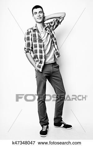 Fashion photo of young model man on white background. Boy