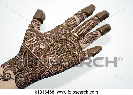 Henna Tattoo On Hands Stock Photo K1316468 Fotosearch It was basically applied by asians during wedding ceremonies, but nowadays the tattoos are increasingly taking over the tattoo industry. henna tattoo on hands stock photo