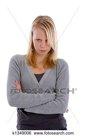 Pretty Blond Teenager With Her Arms Crossed Looking Stubborn