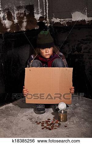Poor beggar boy stock image