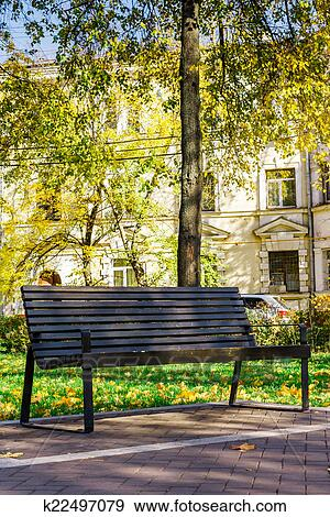 Stock Photograph Of Wooden Bench In A Quiet City Park K22497079