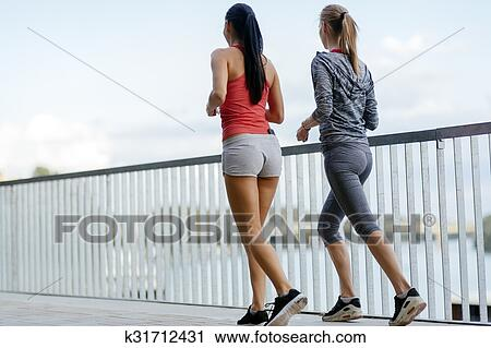 Fit Women Jogging Outdoors Stock Image K31712431 Fotosearch Titles should be in good taste and include the woman's name if known. fotosearch