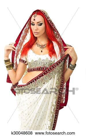 431853a00b Beautiful Redhead Young Sexy Woman in Traditional Indian Clothing with  Bridal Makeup and Oriental Jewelry. Beautiful Girl Bollywood dancer  (Bellydancer) in ...