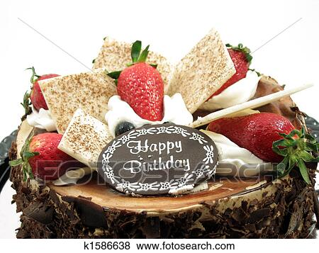 Toppings Of A Chocolate Birthday Cake In Isolated White