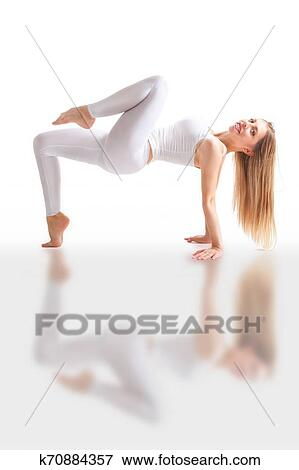 Beautiful Flexible Woman Doing Yoga Poses On White Stock Photo K70884357 Fotosearch
