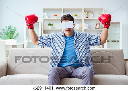 f20cd43573a6 Stock Photography of Man wearing virtual reality VR glasses playing ...