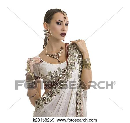fa176aca62 Beautiful Young Indian Woman in white and red Traditional Clothing with Bridal  Makeup and Oriental Jewelry. Beautiful Girl Bollywood dancer (Bellydancer)  in ...