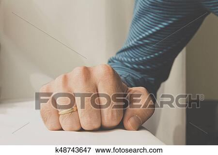 Picture Of Man With A Wedding Ring Squeezed His Hand On White Cloth
