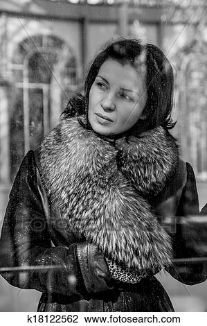 Vintage Beautiful Woman In Winter Beauty Fashion Model Girl In A Fur Hat Russian Stylish Young Portrait Stock Image