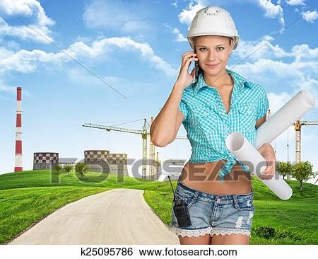 stock images of woman in hard hat holding drawing rolls calling on