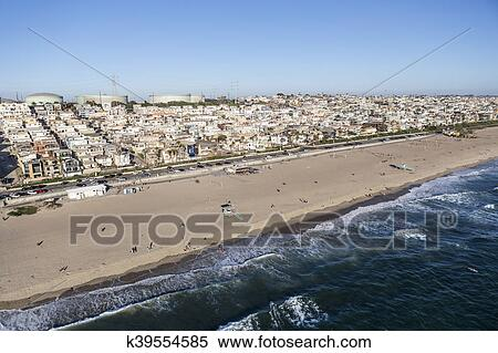 Afternoon Aerial View Of Broad Sandy Beaches And Layers Housing In Manhattan Beach Near Los Angeles California