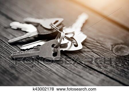 Picture The Bunch Of Keys On A Wooden Table Fotosearch Search Stock