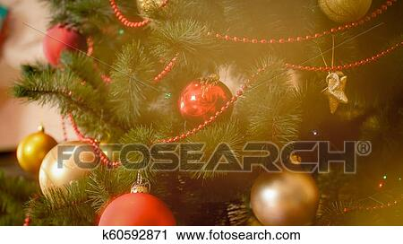 Closeup Photo Of Adorned Christmas Tree And Golden Bokehs Stock