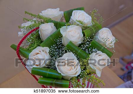 Beautiful Flower Bouquet Of White Roses In Big Round Red Hat Box Work Florist Mother S Day Stock Photography K51897035 Fotosearch