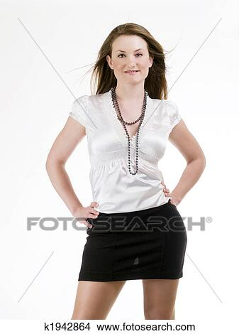 c1be8e2dbe Young woman in black skirt and white blouse Picture   k1942864 ...