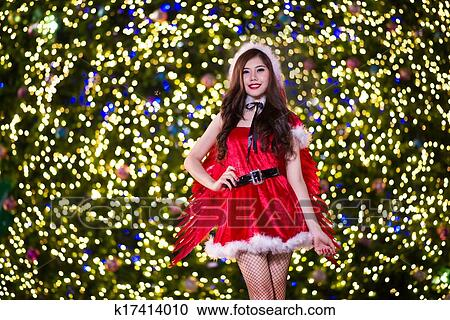 Stock Photography of Pretty Asian girl in Santa costume for ...
