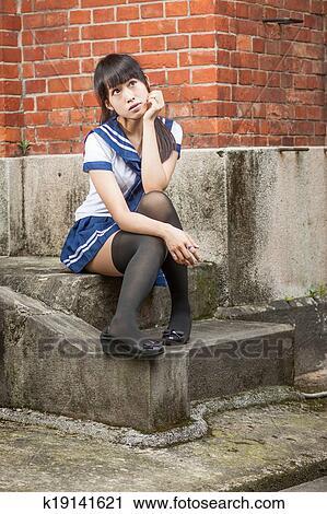 Stock Photography Asian Schoolgirl Sitting In Front Of School Fotosearch Search Stock Photos