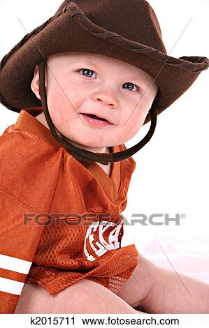Happy smiling 6-month old baby boy portrait wearing cowboy hat and shirt  reads texas bcb5586d2a1