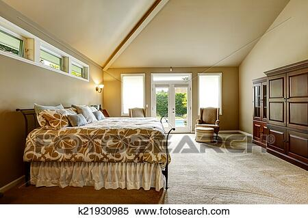Luxury House Interior Bedroom With High Vaulted Ceiling And Wal Stock Photography K21930985 Fotosearch