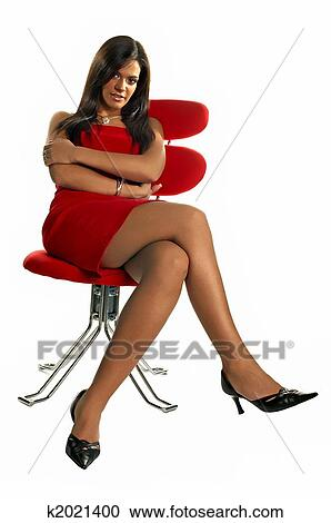 Sexy Beautiful Brunette In Red Chair On White Background