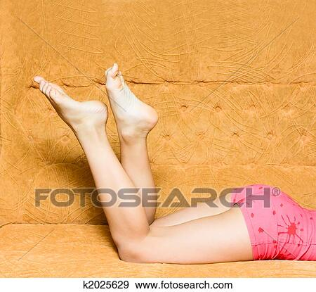 Stock Photograph Teen Girl Legs On Sofa Fotosearch Search Stock Photography Posters
