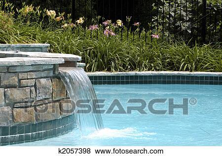Swimming pool waterfall Stock Photo