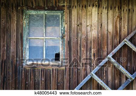 Old Broken Window In The Wooden Wall Of The House And Old Wooden Ladder Stock Image K48005443 Fotosearch