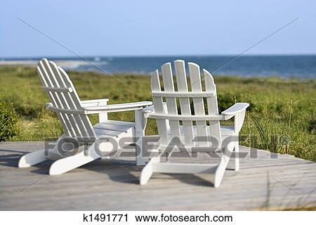 Adirondack Chairs On Deck Looking
