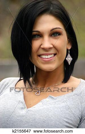 https://fscomps.fotosearch.com/compc/CSP/CSP215/beautiful-model-smiling-stock-photo__k2155647.jpg