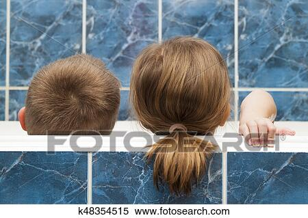 Stock Image of Brother and sister taking a bubble bath. Little boy ...