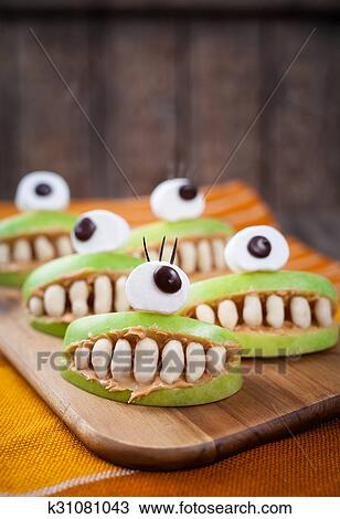 Stock Photo of Scary halloween food monsters healthy natural snack ...