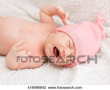 Stock photo crying newborn baby girl fotosearch search stock photography print pictures