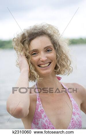Mature curly blond