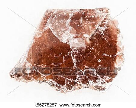 Raw Brown Mica Lamina On White Marble Stock Photo