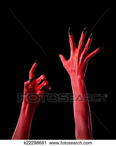 stock photography of red spooky devil hands with black nails real