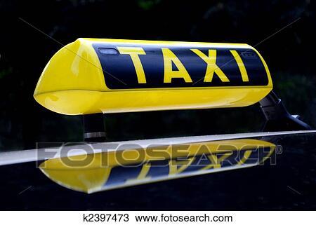 Stock Foto Gelb Neon Taxi Zeichen Widerspiegelnd Auto Dach
