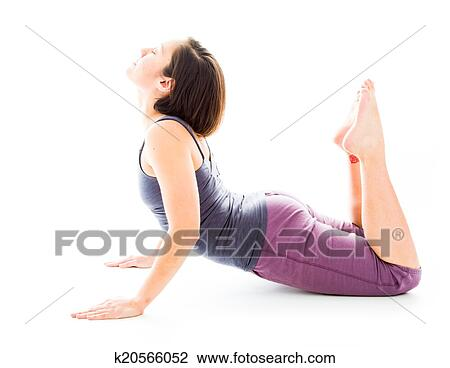 young woman practicing yoga in cobra pose stock image