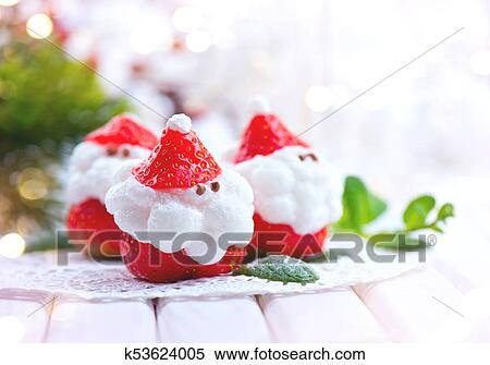 Christmas strawberry Santa. Funny dessert stuffed with whipped cream. Xmas party food idea